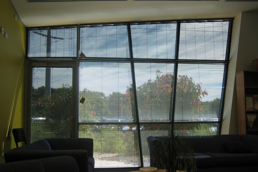 Easytilt System 2.1a. Aluminium Venetian Blind custom made to window angles in Perforated Black.